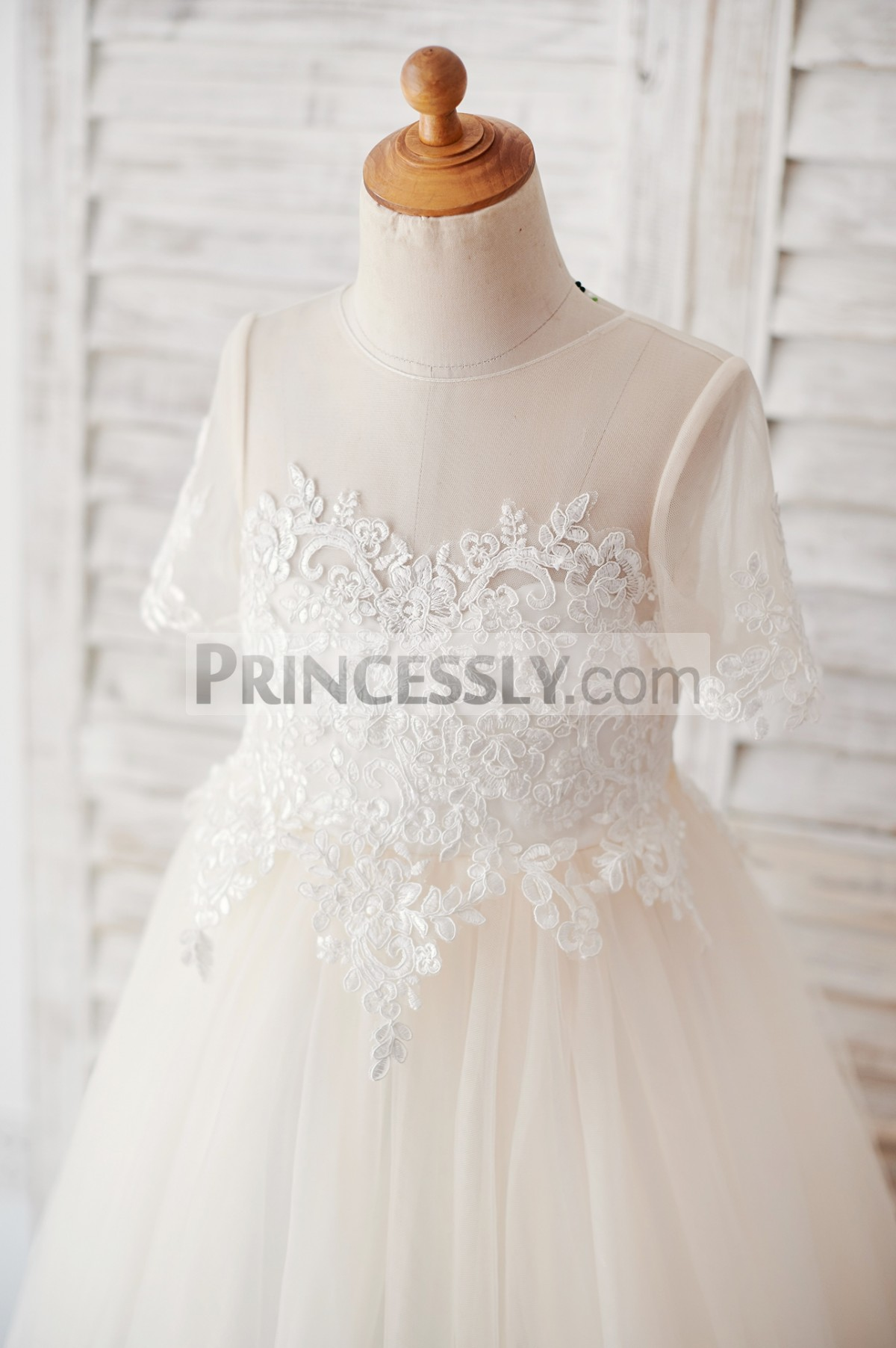 Sheer neck, short sleeves bodice with ivory lace appliques