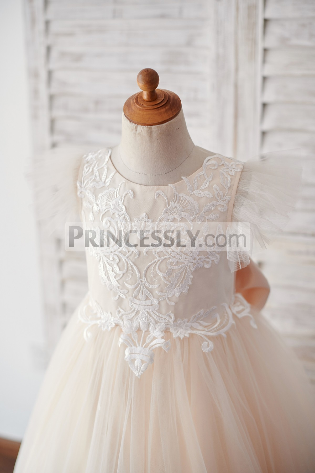 Ivory lace appliqued bodice in ruffles tulle cap sleeves