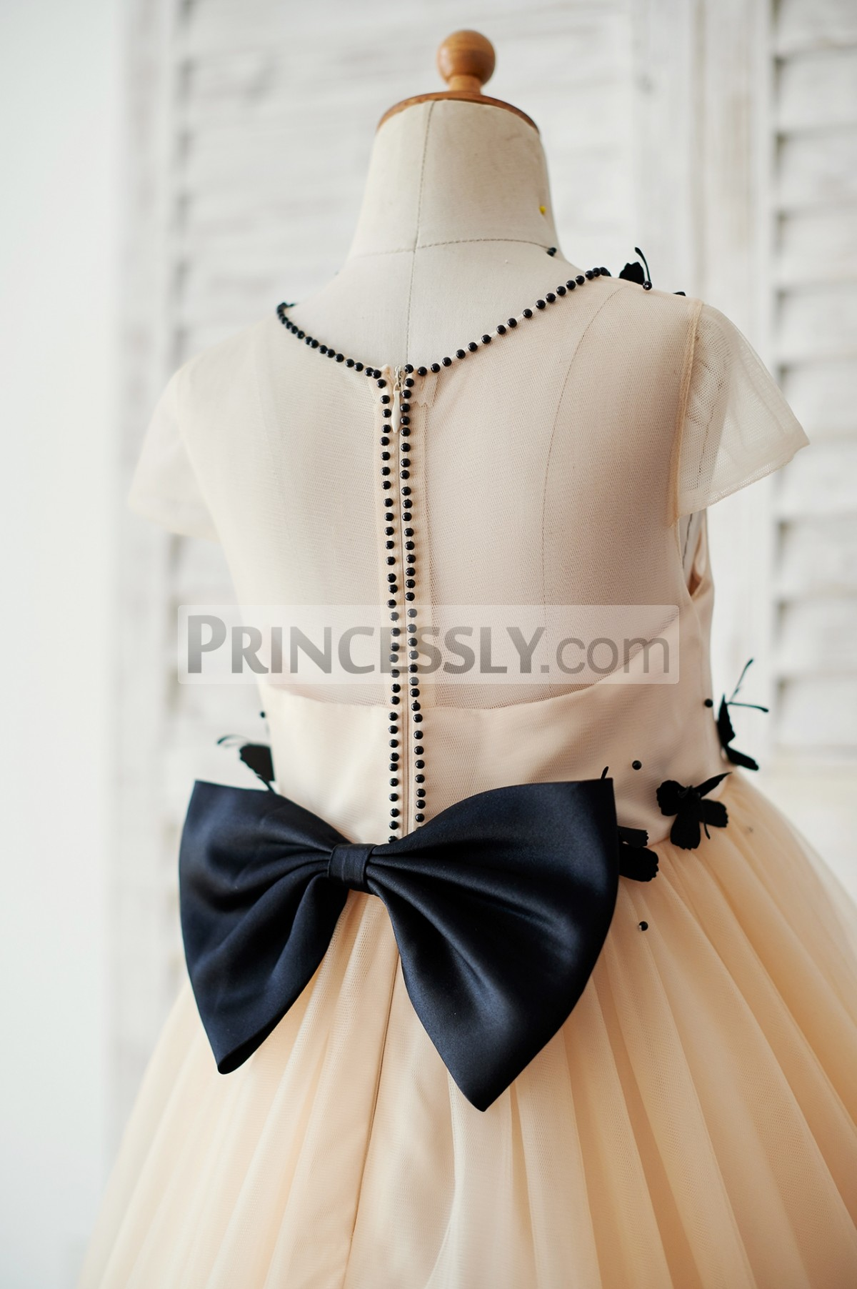 Sheer back with a bow & black beads along hidden zipper