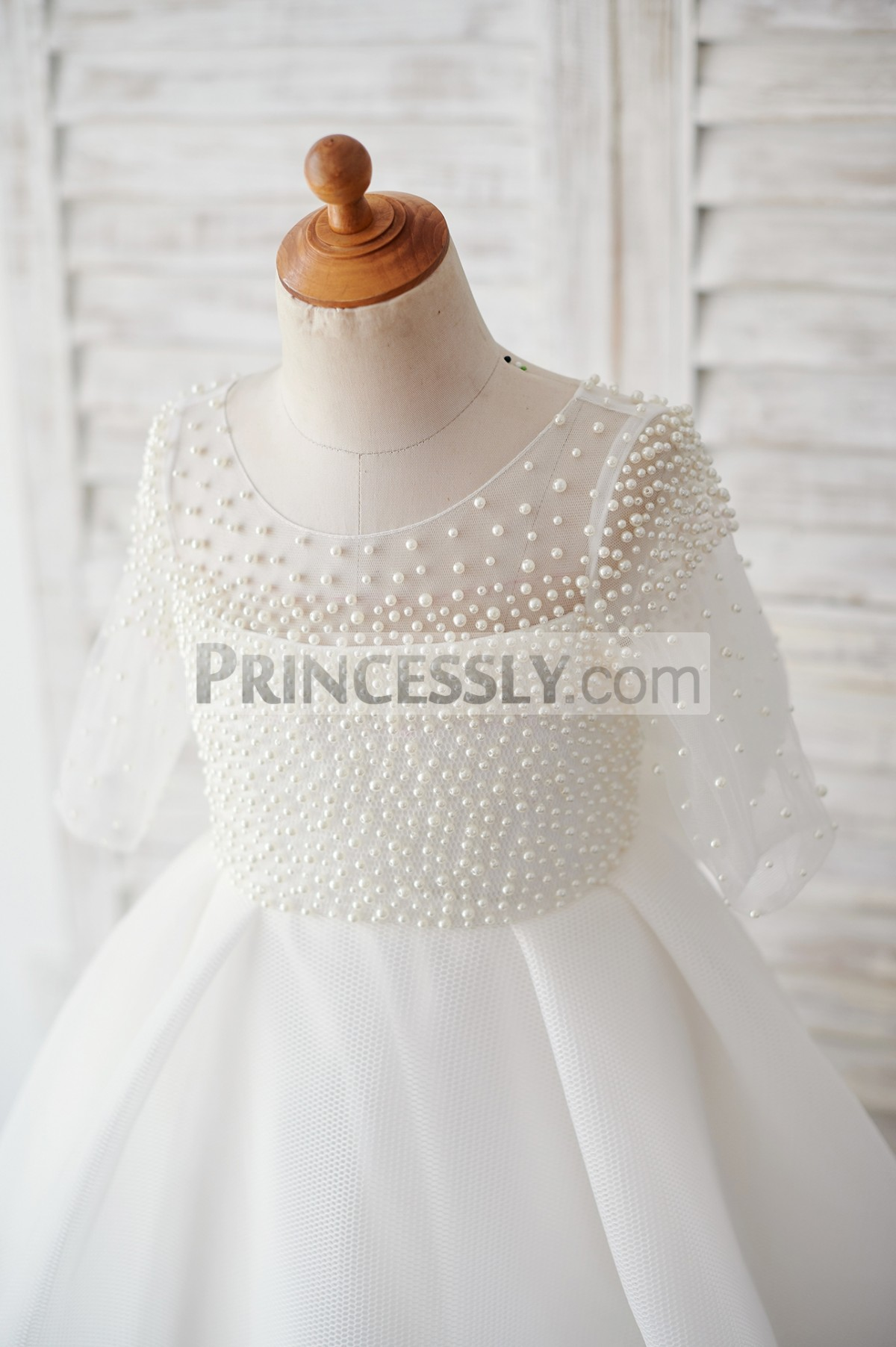 Pearled  bodice is inside straight lining & elbow sleeves