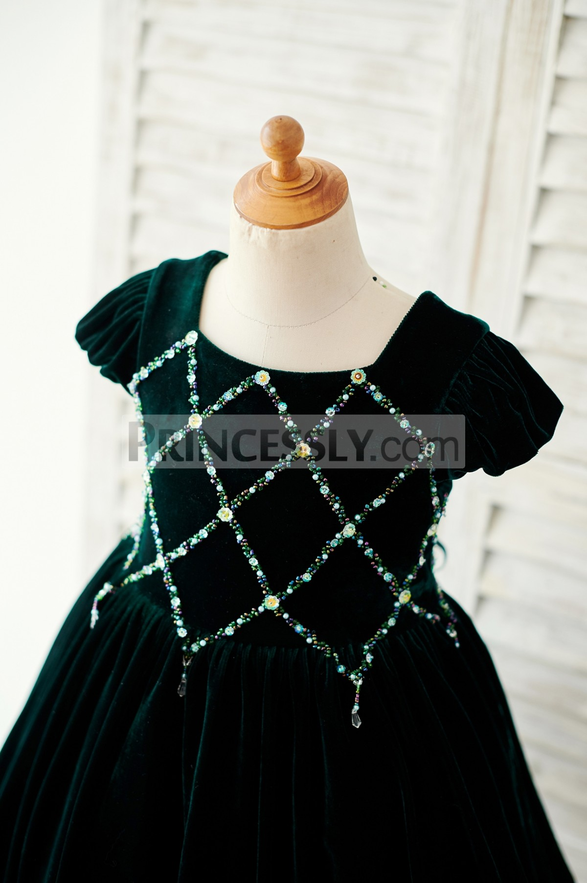 Square neck, puffy cap sleeves bodice with colorful beads
