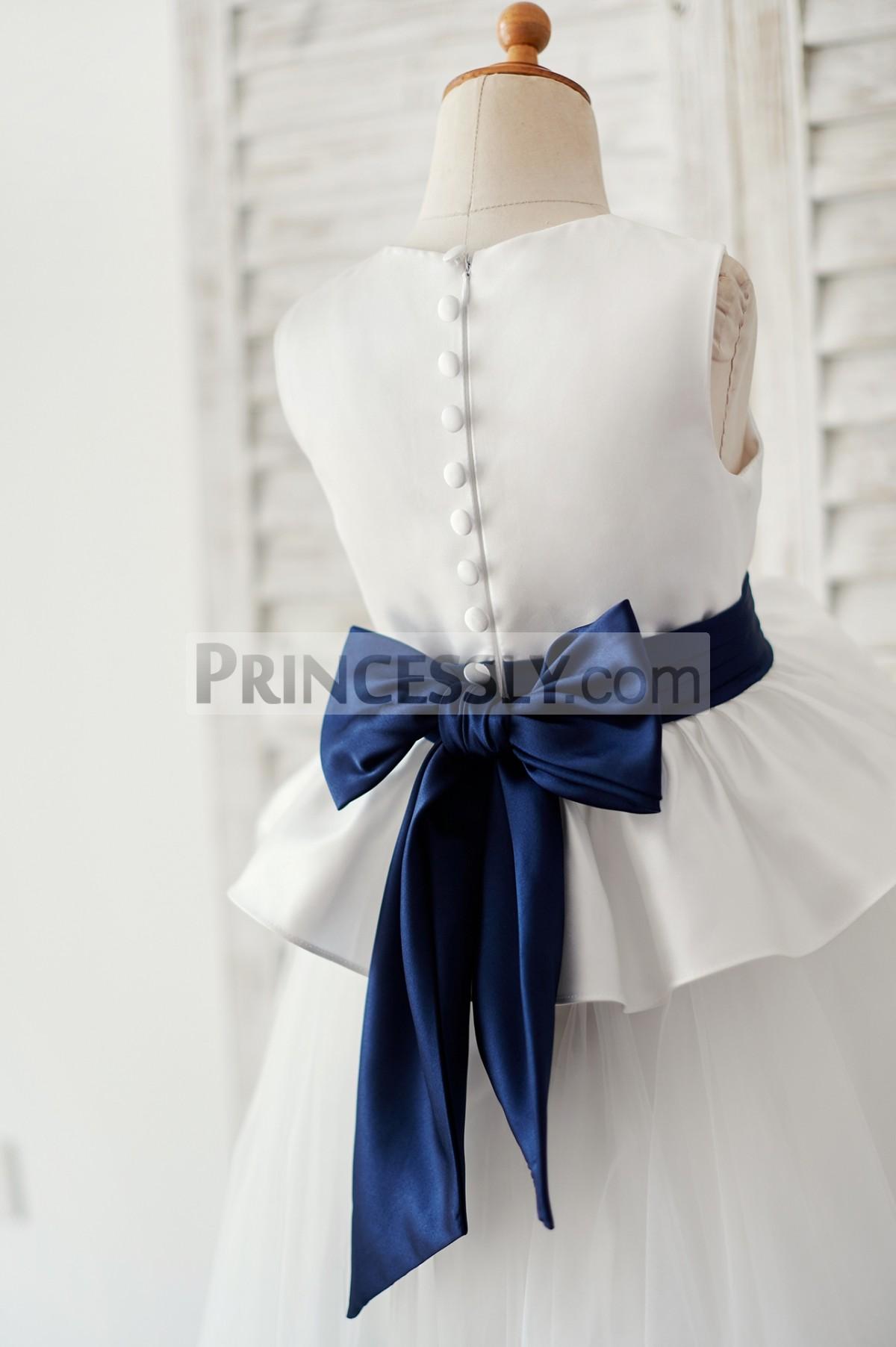 Cloth buttons along hidden zipper closure back with navy blue bow