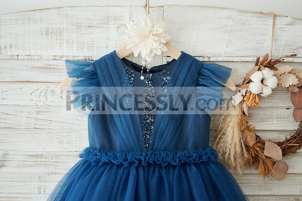 Navy blue glitter tulle bodice in ruffled cap sleeves and waistline