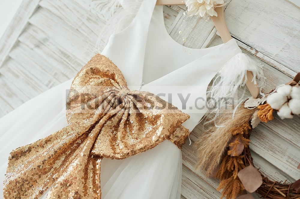 Big gold sequined bow on back