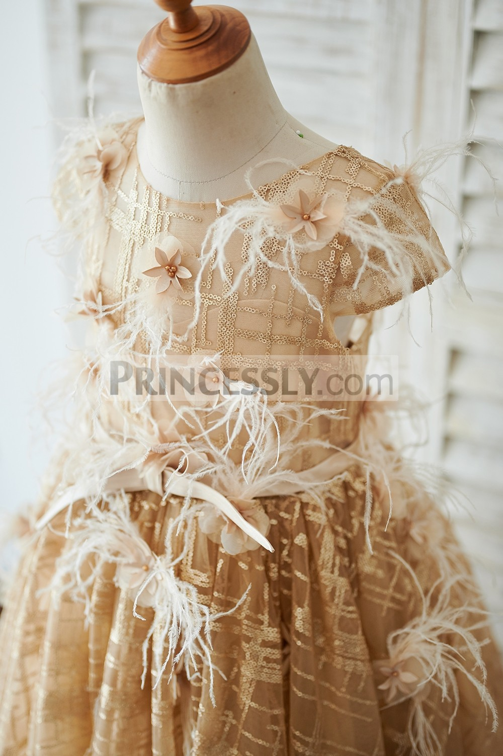 Cap sleeves inside sweetheart sequined bodice with belt