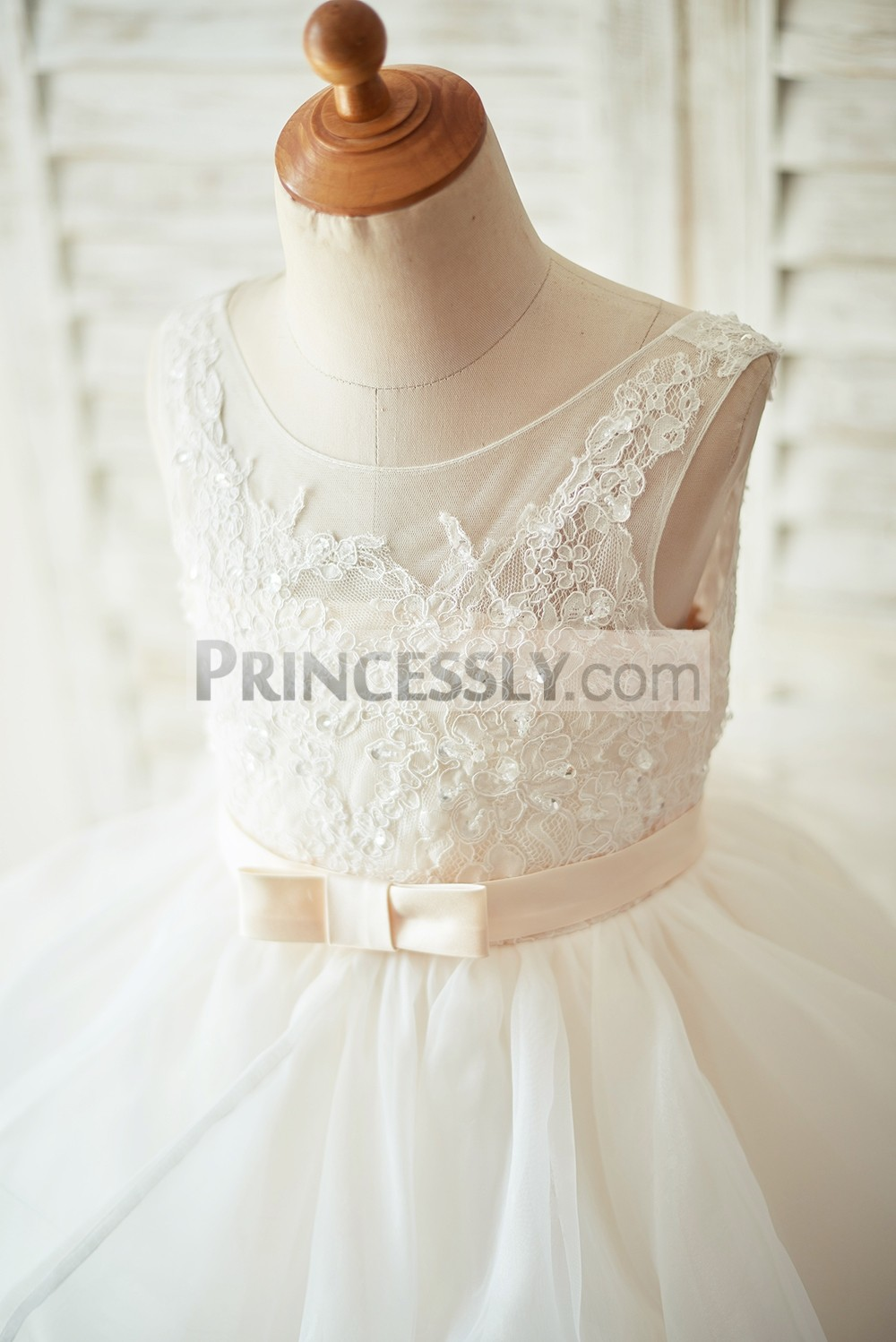Beaded ivory lace bodice with champagne belt / bow